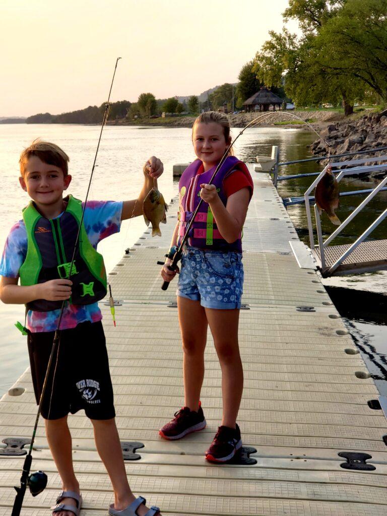 Kids fishing show their big catch