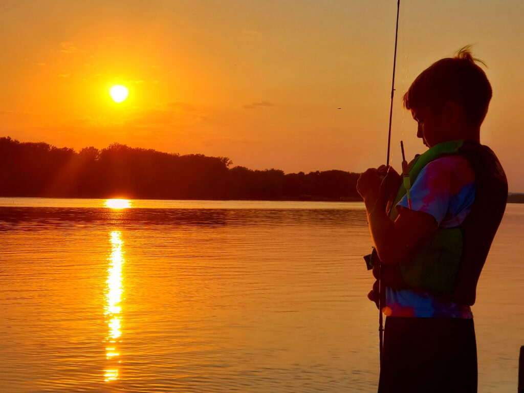 Young boy fishing at night - very cool