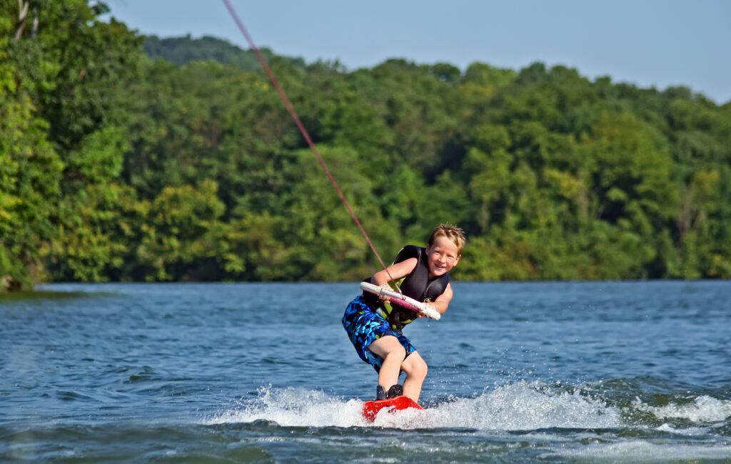 Very Young Boy Wakeboarding